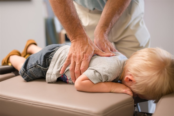 Why should parents take kids to a chiropractor?